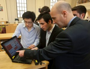 Bruno Delorme, right, shows students Tony Zhang, Elhanan Moryoussef,
